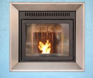 Modern stove with a warm flame Stock Images