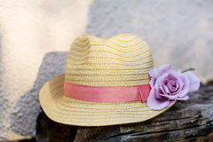 Modern straw hat with pink rose Royalty Free Stock Photo