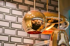Modern streamlined mirror oval copper chandelier. Bubble metal copper shade pendant.  Stock Image