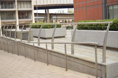Silver railings leading to shops Stock Photography