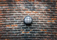 Modern street electric lamp on the old brick wall Stock Photo