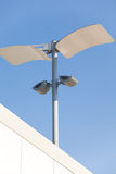 Modern street lamp. Over blue sky stock photography