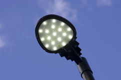 A modern street lamp against a blue sky. Royalty Free Stock Photography