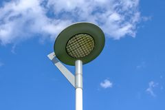 A modern street LED light on blue sky background