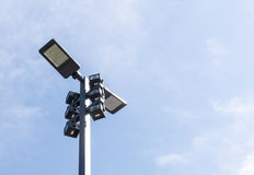 Modern street lighting against blue sky. Bottom view - horizontal image stock photography