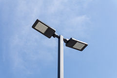 Modern street lighting against blue sky. Bottom view - horizontal image stock image