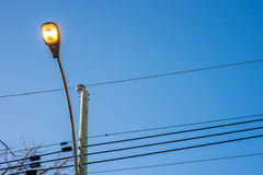 Modern street lights illuminated Stock Photography