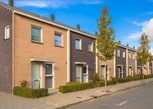 Modern Street Terrace Houses. Modern Street with Terraced Houses in Suburban Neighborhood Stock Photos