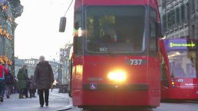 Modern streetcar carrying passengers in old European city, public transport. Stock footage stock video