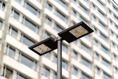 Modern streetlamp and concrete building Stock Image
