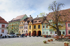 Modern streets of Sighisoara, Romania. Sighisoara, Romania - October 19th, 2016: Famous view of central square in historic part of Sighisoara, Transylvania Stock Image