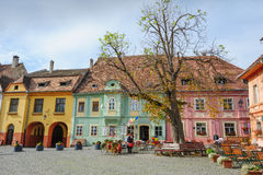 Modern streets of Sighisoara, Romania. Sighisoara, Romania - October 19th, 2016: Famous view of central square in historic part of Sighisoara, Transylvania Stock Photography