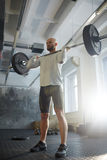 Modern Strongman Lifting Barbell in Gym Royalty Free Stock Image