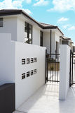 Modern stucco homes. Stunning modern stucco residential units behind security gates stock image