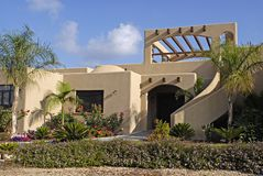 Modern Stucco House. Complete with tropical landscaping Stock Photos