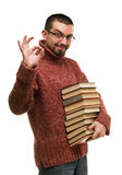Modern student with glasses pleased keeps stack of books Royalty Free Stock Image