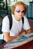 Modern student lifestyle. Caucasian student outdoors holding skateboard Stock Image