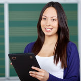 Modern student using digital pad in class room Stock Images