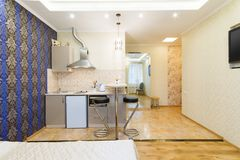 Modern Studio Apartment. Kitchen and living room Royalty Free Stock Photos