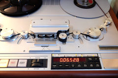 Modern studio stereo tape recorder with magnetic tape front view closeup Stock Image