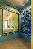 Modern style of bathroom,shower on blue pattern wall. That can see bedroom through transparent mirror stock image