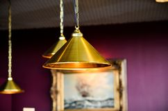 Modern style bronze decoration lamps in pub stock images