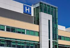 Building with large H sign for hospital stock images