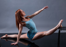 Modern style dancer. Female performing on gray background royalty free stock photo