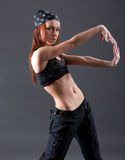 Modern style dancer. Female performing on gray background royalty free stock image