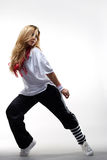 Modern style dancer. Posing behind studio background Stock Photography