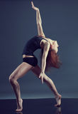 Modern style dancer. Female performing on gray background royalty free stock images