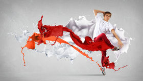 Modern style dancer. Jumping and paint splashes Illustration stock images