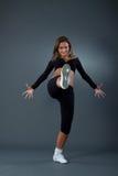 Modern style dancer posing. On studio background stock photography