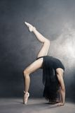 Modern style dancer posing on grey background Stock Photos