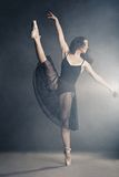 Modern style dancer posing on grey background Stock Image