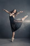 Modern style dancer posing on grey background Royalty Free Stock Image