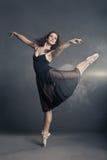 Modern style dancer posing on grey background Royalty Free Stock Image