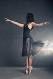 Modern style dancer posing on grey background Royalty Free Stock Photo