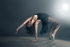 Modern style dancer posing on grey background Stock Photo