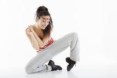Modern style dancer. Posing on studio background Stock Photos