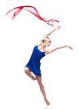 Modern style dancing girl. Studio picture of young caucasian blond girl in blue dress which is dancing with red flying cloth. modern style. isolated on white stock photos