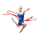Modern style dancing girl. Studio picture of young caucasian blond girl in blue dress which is dancing with red flying cloth. modern style. isolated on white Royalty Free Stock Photography