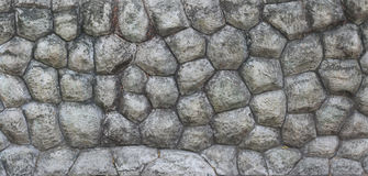 Modern style design decorative uneven cracked real stone wall surface with cement Royalty Free Stock Photography