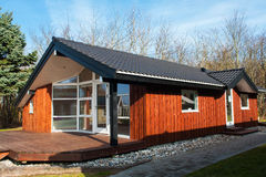 Modern design attractive small wooden home Stock Photography