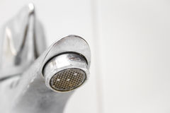 Modern style dirty faucet, small depth of field Royalty Free Stock Image