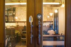 Modern style door handle on glass door stock images