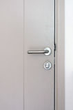 Modern style door handle and lock Royalty Free Stock Photo