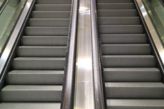 Modern style double escalator staircase in a shopping mall. Background Stock Image