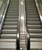 Modern style double escalator staircase in the shopping mall. Vertical image of modern style double escalator staircase in the shopping mall Stock Images