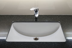 Modern style faucet with black granite top Royalty Free Stock Images